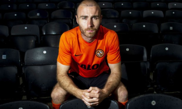 Dundee United captain Sean Dillon in the new strip after signing his deal.