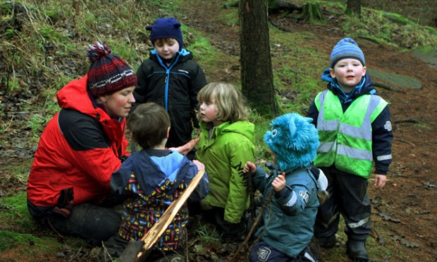 Practitioner Sarah Hutcheon with some of the children from the Secret Garden Outdoor Nursery in Fife.