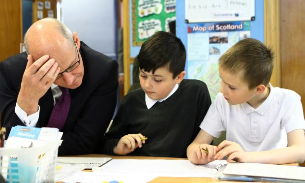 John Swinney chats to some of pupils in the P4 maths class at Dundee's Dens Road Primary School after the numeracy statistics were announced.