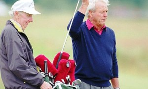Arnold Palmer at the Open Championship with faithful caddie Tip Anderson in 1995.