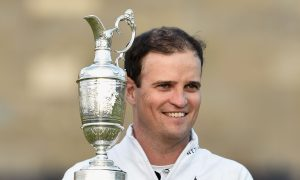 US golfer Zach Johnson holds the Claret Jug after winning the 144th Open Championship at The Old Course last year.