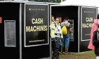 A security guard stands alongside cash machines, where one was stolen at T in the Park.