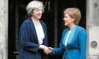 Prime Minister Theresa May (left) is greeted by  Nicola Sturgeon at Bute House in Edinburgh.