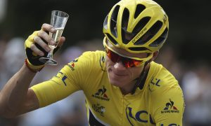 Chris Froome celebrates victory in the traditional style.