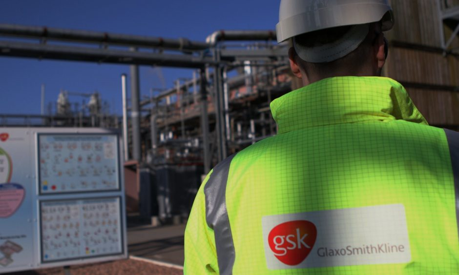 A worker at GlaxoSmithKline's plant at Montrose.