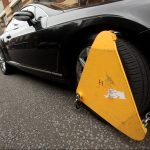 Fife fines dodger pays up £1,600 after car is clamped