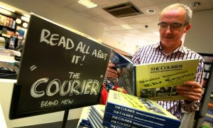 Waterstone's Dundee manager Kevin Breen with the new book on The Courier.