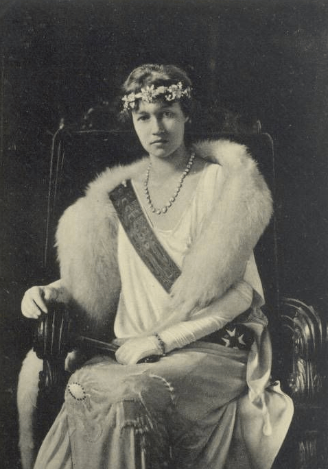 Charlotte wears a floral bandeau and a diamond riviere in this portrait, ca. early 1920s