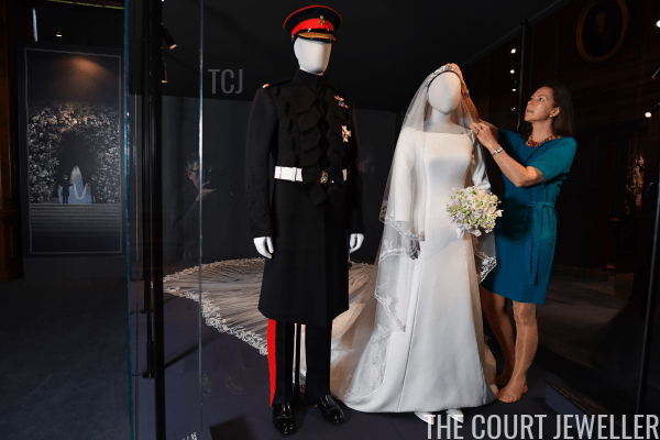 """Caroline Guitaut, senior curator of the Royal Collection, prepares the """"A Royal Wedding: The Duke and Duchess of Sussex"""" exhibition at the Palace of Holyroodhouse in Edinburgh, June 2019 (Jeff J Mitchell/Getty Images)"""