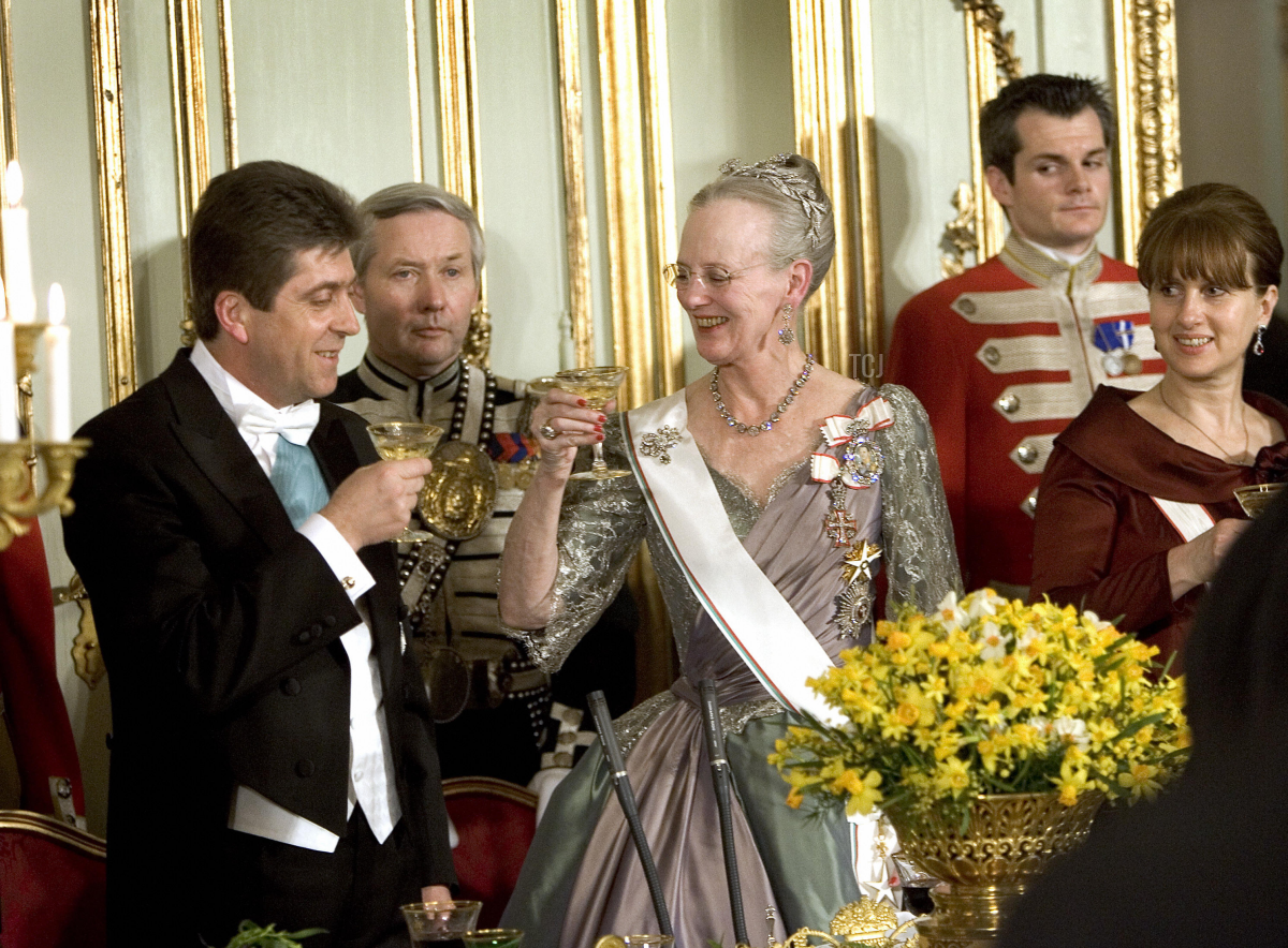 President of Bulgaria Georgi Parvanov (L) and Danish Queen Margrethe (c) Toast as Zorka Parvanova, wife of Bulgarian president (R) looks on at the state banquet at Amalienborg Castle 29 March 2006