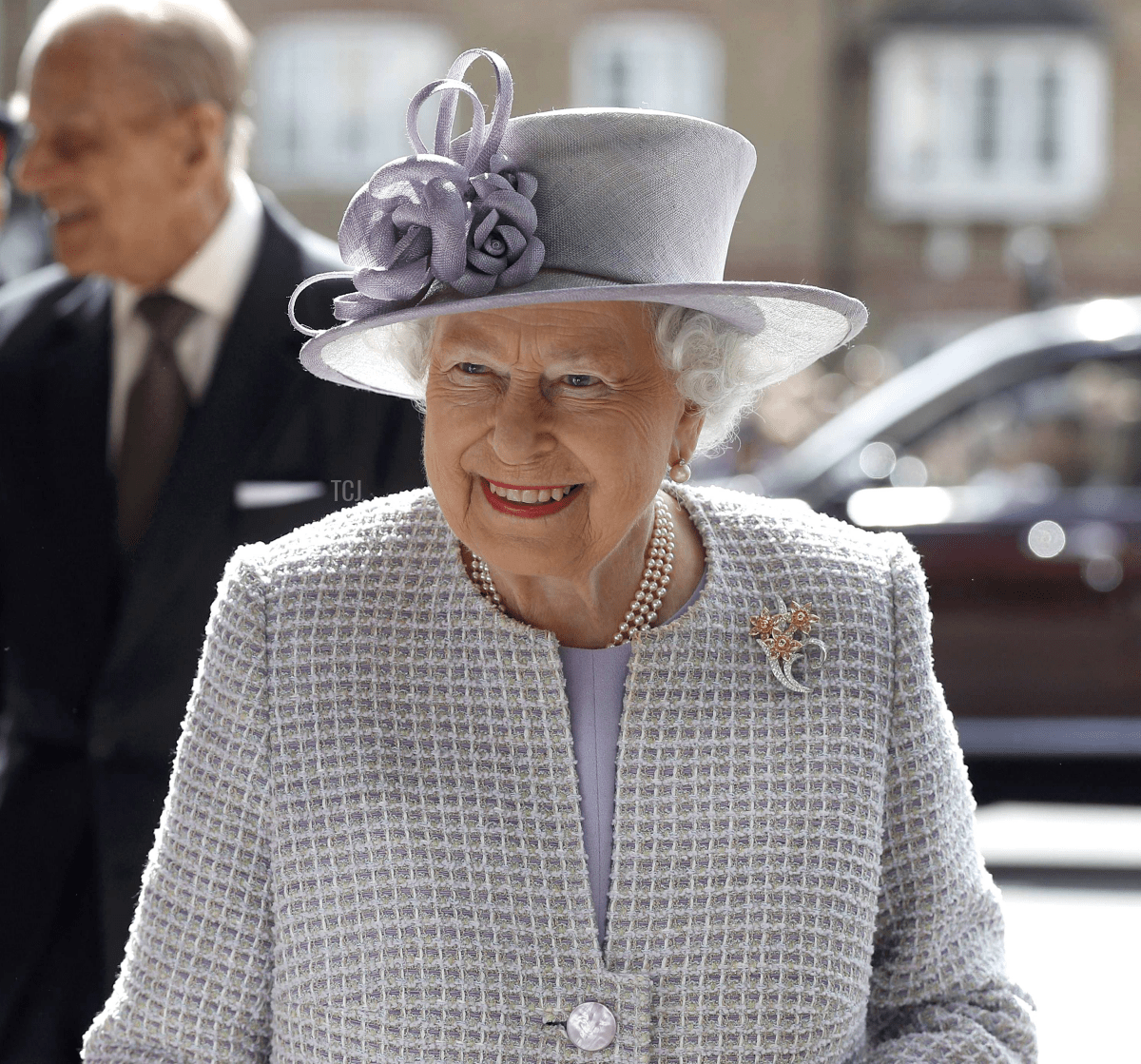 Queen Elizabeth II smiles as she arrives to meet residents during a visit to Priory View, an independent living scheme for older residents, in Dunstable on April 11, 2017
