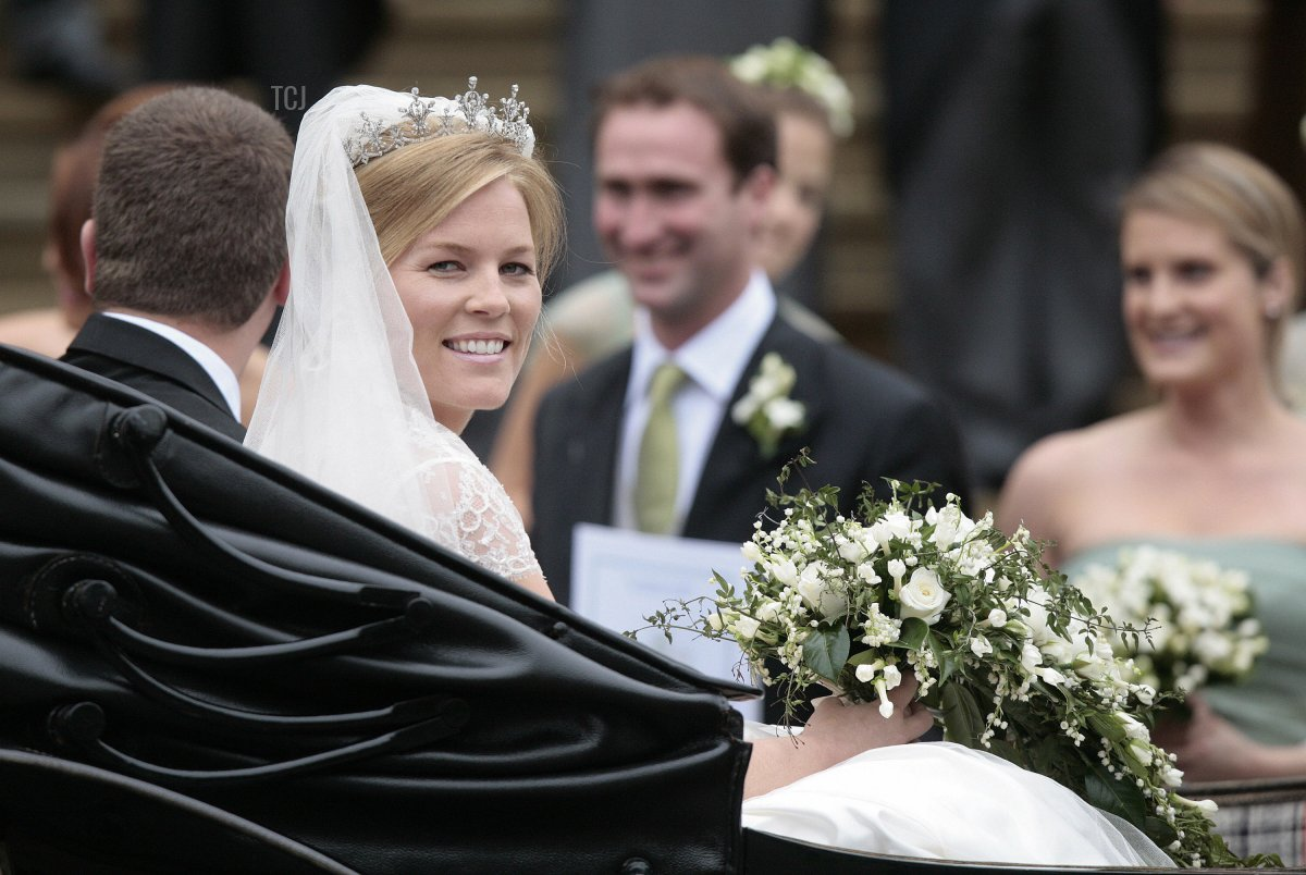 Peter Phillips 30, (L) and Autumn Kelly 31, (2nd R) leave St George's Chapel in Windsor on May 17, 2008 after their marriage vows