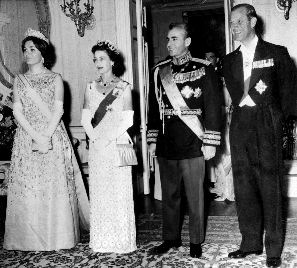The Queen Elizabeth II and the Prince Philip pose with Iran Shah Mohammad Reza Pahlavi and his wife Farah Pahlavi during their state visit, March 1961 in Tehran