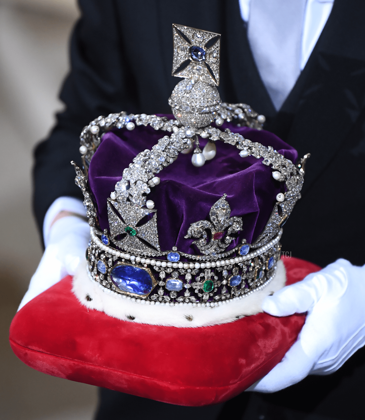 The Imperial State Crown is carried through the Sovereign's entrance ahead of the state opening of parliament at the Houses of Parliament on December 19, 2019 in London