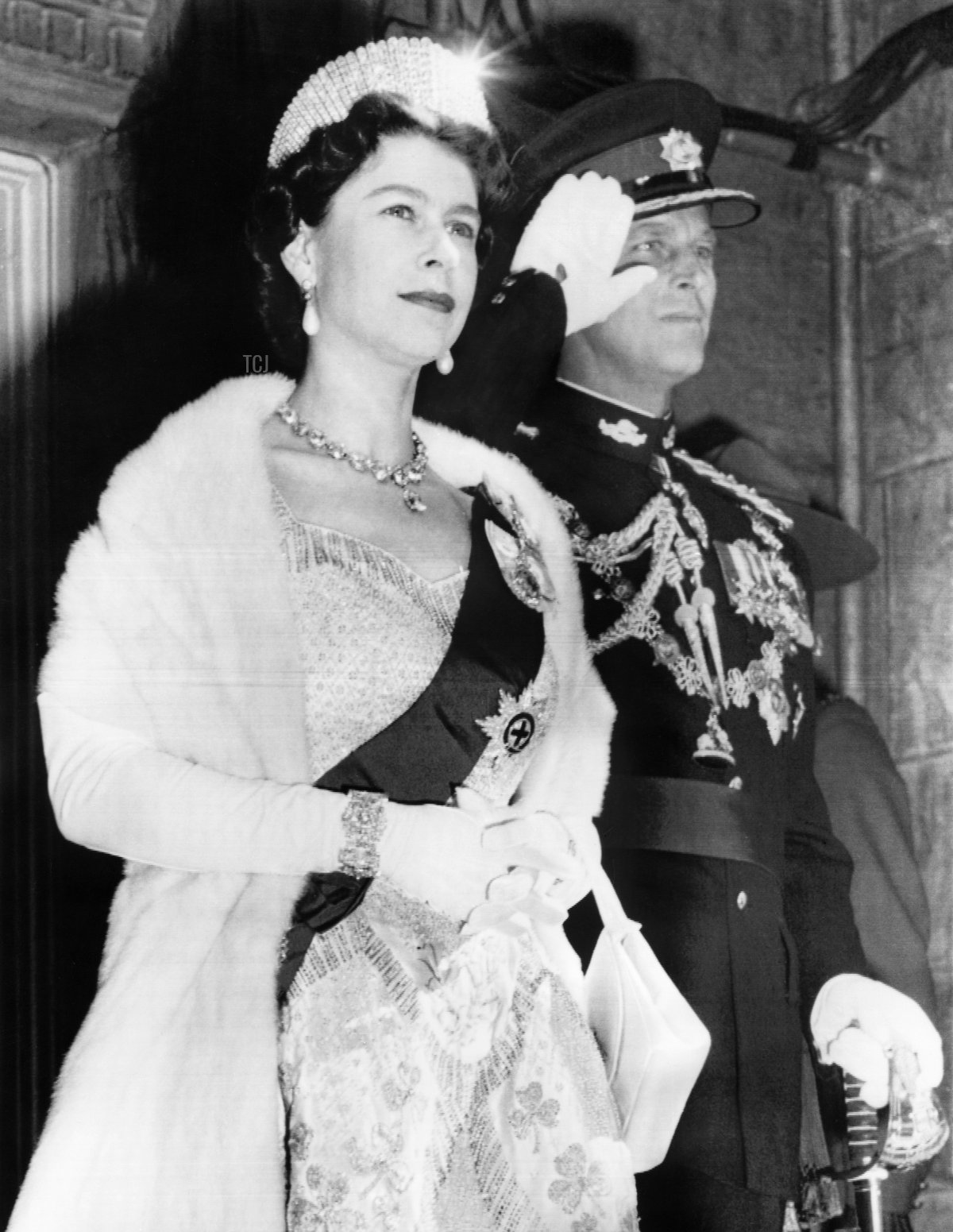 Britain's Queen Elizabeth II and Prince Philip, Duke of Edinburgh (R) attend the ceremonies marking the opening of Parliament in Ottawa on October 14, 1957
