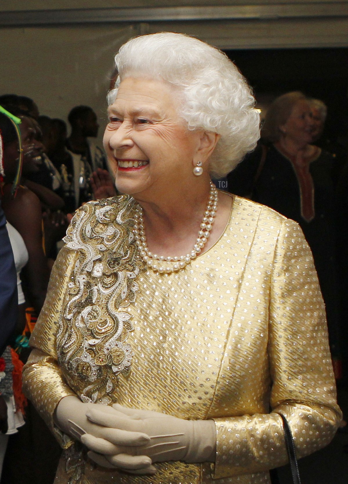 Queen Elizabeth II greets performers backstage during the Diamond Jubilee Concert outside Buckingham Palace in London, on June 4, 20112.The star-studded musical extravaganza comes on the third of four days of celebrations to celebrate Queen Elizabeth II's 60 years on the throne