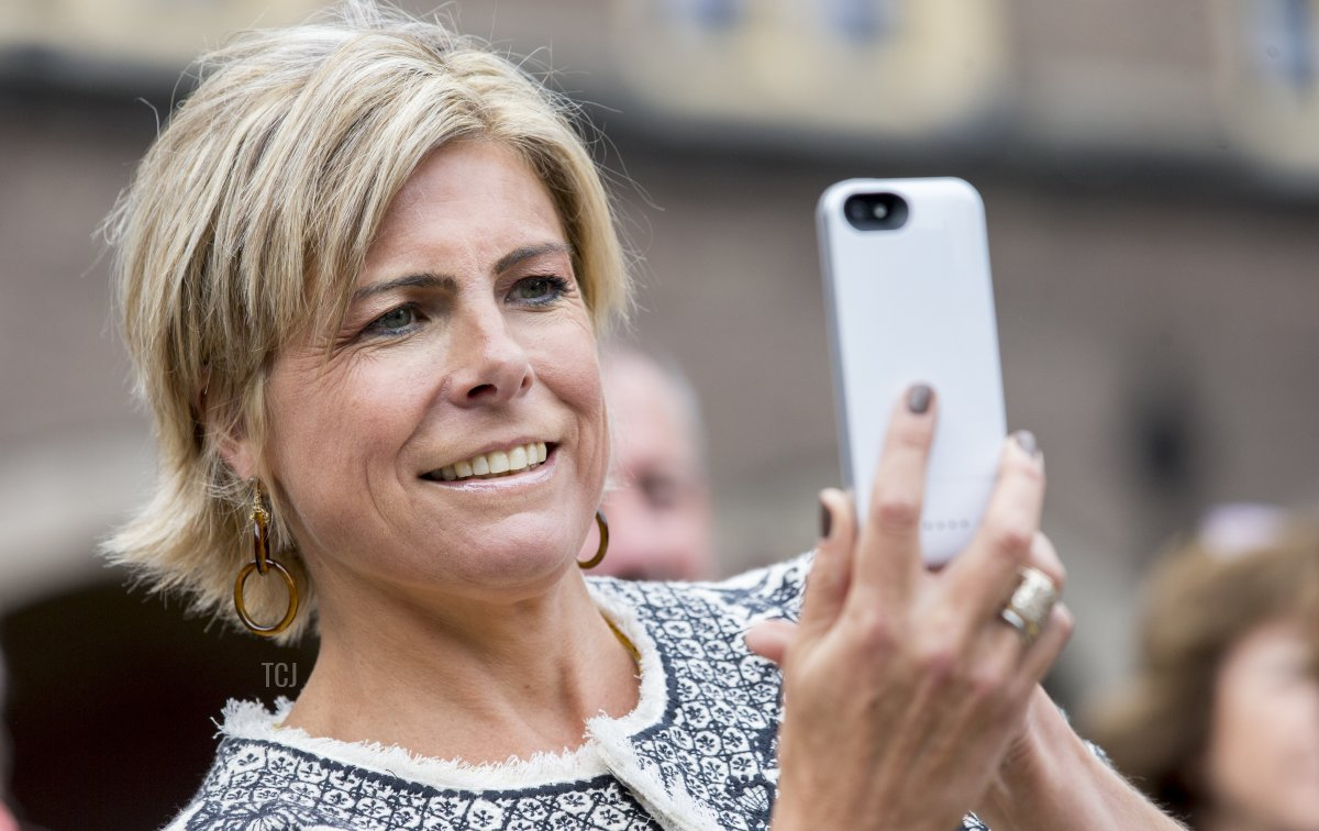 Dutch Princess Laurentien takes a picture with her phone as she attends the opening of the Literacy Week at the Binnenhof in The Hague, on September 7, 2015. The Princess is chairman of the Reading & Writing Foundation