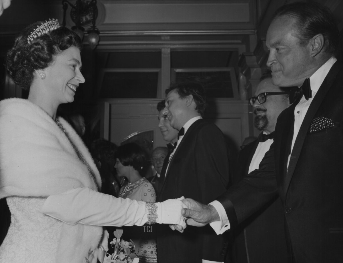 Queen Elizabeth II shaking hands with Bob Hope, with Mireille Mathieu, Ken Dodd and Harry Secombe in the background, at the Royal Variety Performance, London Palladium, November 13th 1967