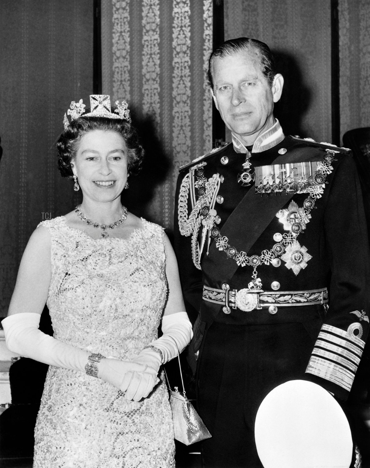 Official photo taken on November 3, 1972 shows Britain's Queen Elizabeth II, wearing the George IV State Diadem, diamond tiara on British and Commonwealth stamps, and Prince Philip, Duke of Edinburgh, on the occasion of their 25th wedding anniversary