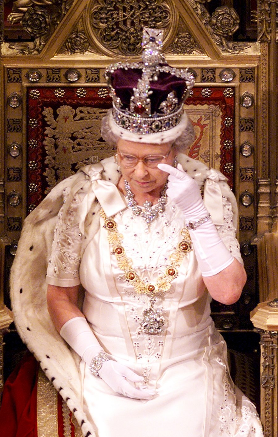 Britain's Queen Elizabeth II wipes her eye following her speech at the State Opening of Parliament 17 November 1999 in the House of Lords. The Queen made her opening speech in which she outlined what her goverment proposes to introduce to parliament and marks the opening of the session