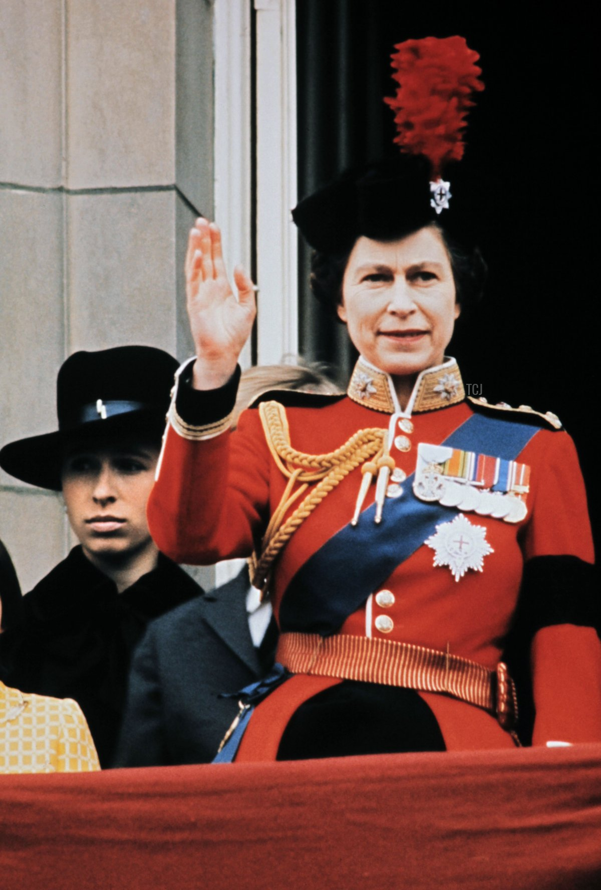 Britain's Queen Elizabeth II (R) waves to the crowd on June 03, 1972 from the balcony of Buckingham Palace in London, during the Trooping the Colour ceremony