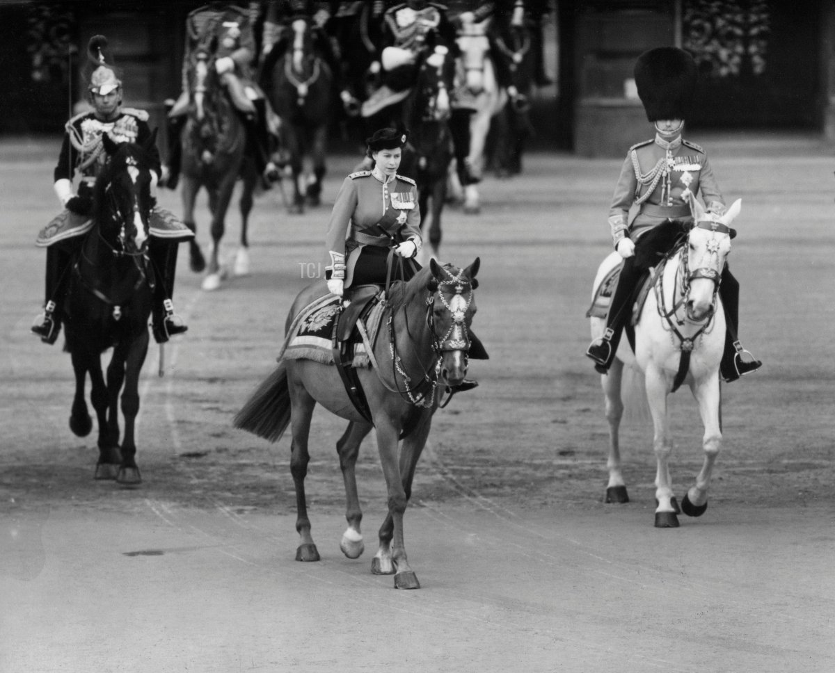 """Picture taken on June 5, 1952 at London, showing Queen Elizabeth II riding away from Buckingham Palace to attend the first """"Trooping of the Colour"""" ceremony of her reign"""