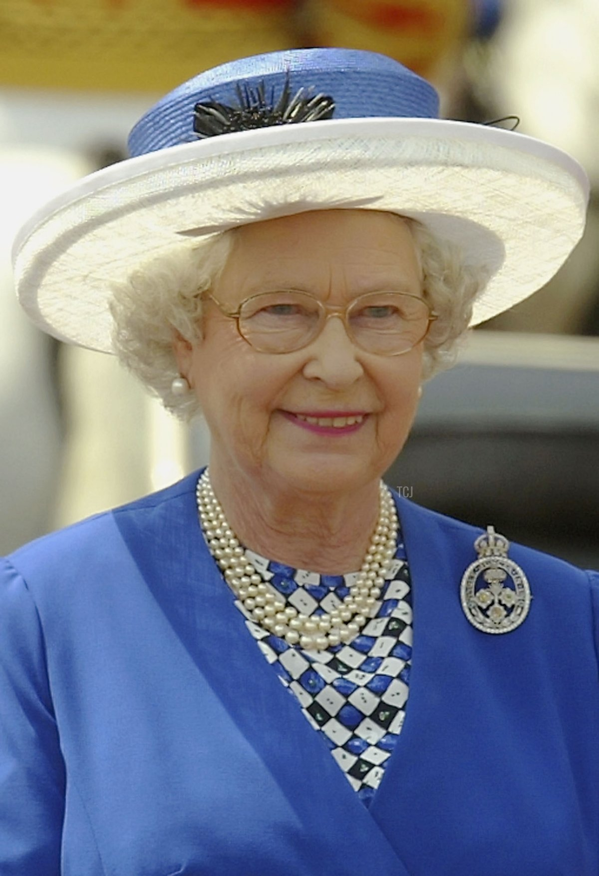 Britain's Queen Elizabeth II smiles as she arrives at Buckingham Palace after attending the Trooping of the Colour ceremony June 14, 2003 in London, England
