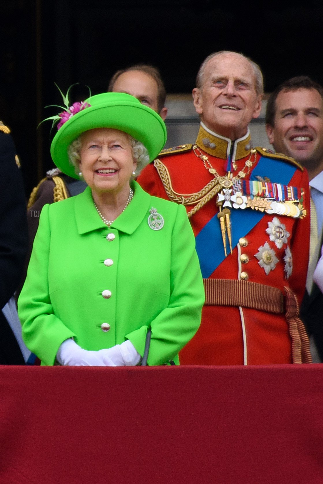 Queen Elizabeth II and Prince Philip, Duke of Edinburgh watch a fly past during the Trooping the Colour, this year marking the Queen's 90th birthday at The Mall on June 11, 2016 in London, England