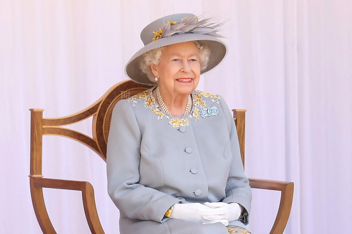 Britain's Queen Elizabeth II watches a military ceremony to mark her official birthday at Windsor Castle on June 12, 2021 in Windsor