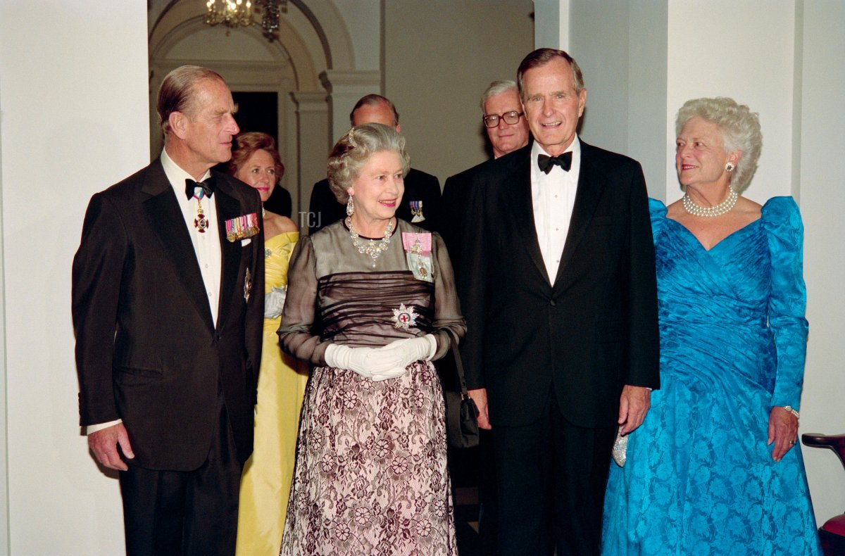 US President George Bush (2nd R) and First Lady Barbara Bush (R) arrive on May 16, 1991 at a reciprocal dinner at the British Embassy accompanied by Britain's Queen Elizabeth II (2nd L) and her husband, Prince Philip (L). Earlier the Queen addressed a joint session of the US Congress, the first British Monarch to do so