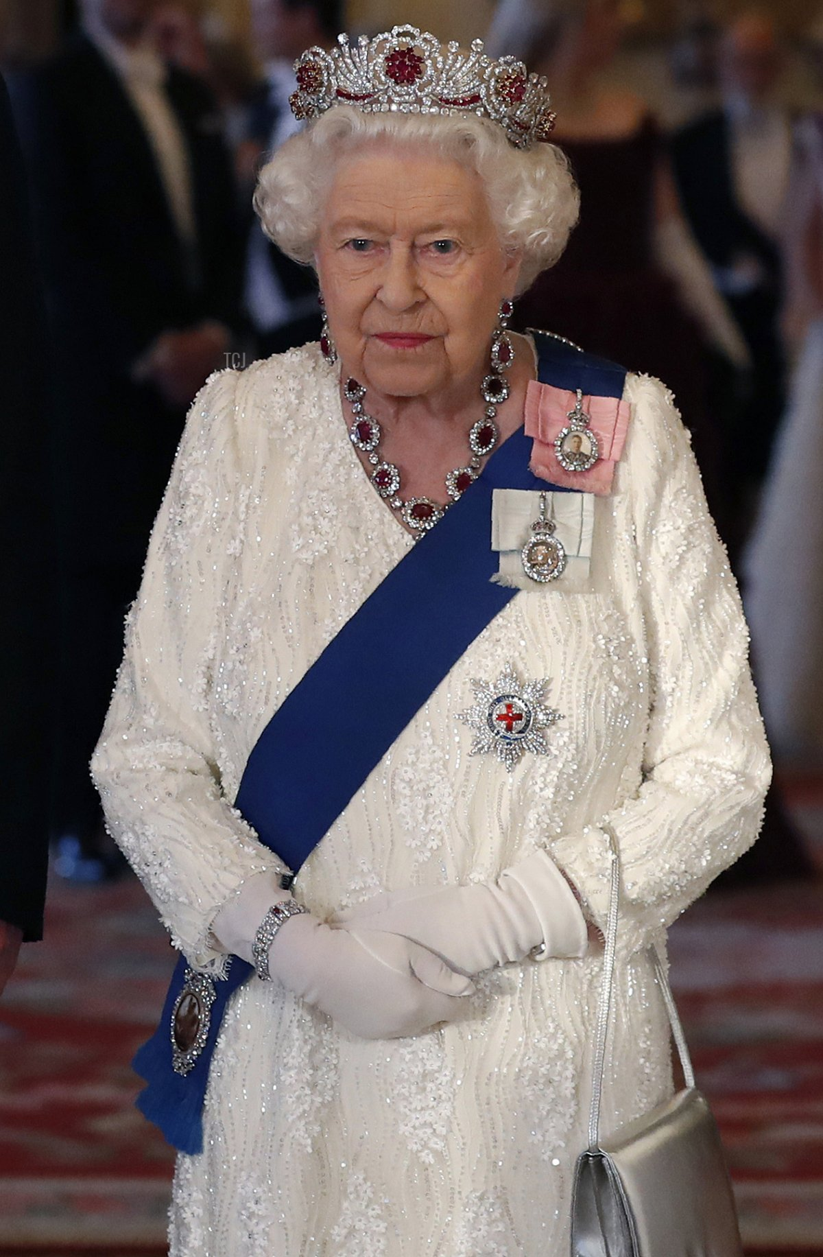 Britain's Queen Elizabeth II reacts as she poses with the US President and US First Lady ahead of a State Banquet in the ballroom at Buckingham Palace in central London on June 3, 2019, on the first day of the US president and First Lady's three-day State Visit to the UK