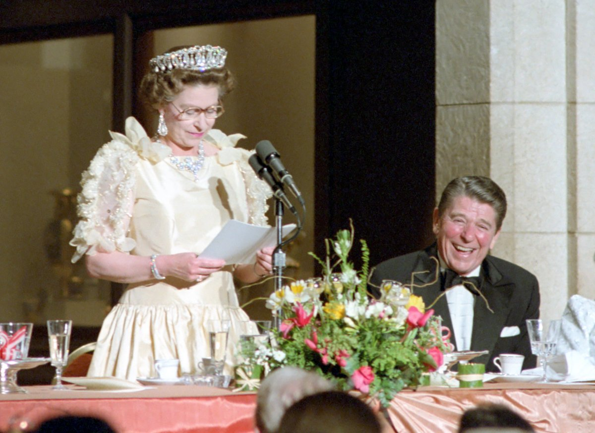 President Ronald Reagan laughing at remarks by Queen Elizabeth II at a dinner honoring her at M.H. De Young Memorial Museum in San Francisco California