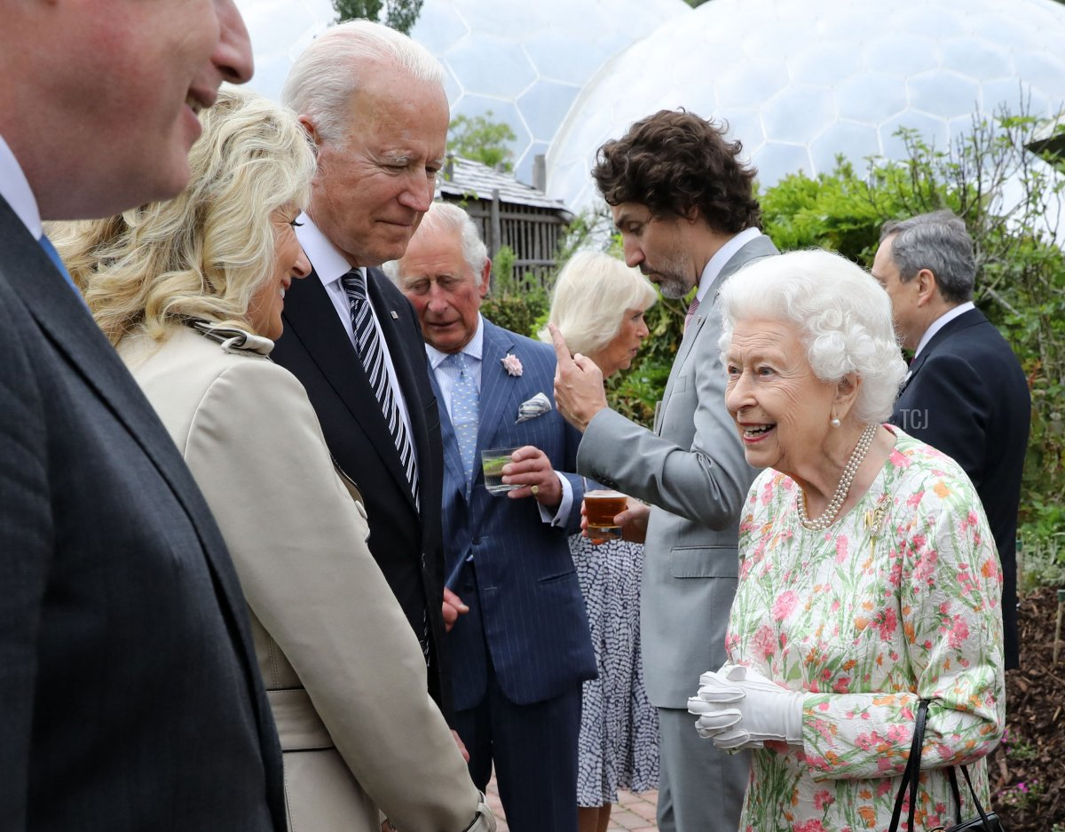 Britain's Queen Elizabeth II (R) speaks with US President Joe Biden and US First Lady Jill Biden and leaders of the G7 during a reception at The Eden Project in south west England on June 11, 2021. - G7 leaders from Canada, France, Germany, Italy, Japan, the UK and the United States meet this weekend for the first time in nearly two years, for three-day talks in Carbis Bay, Cornwall