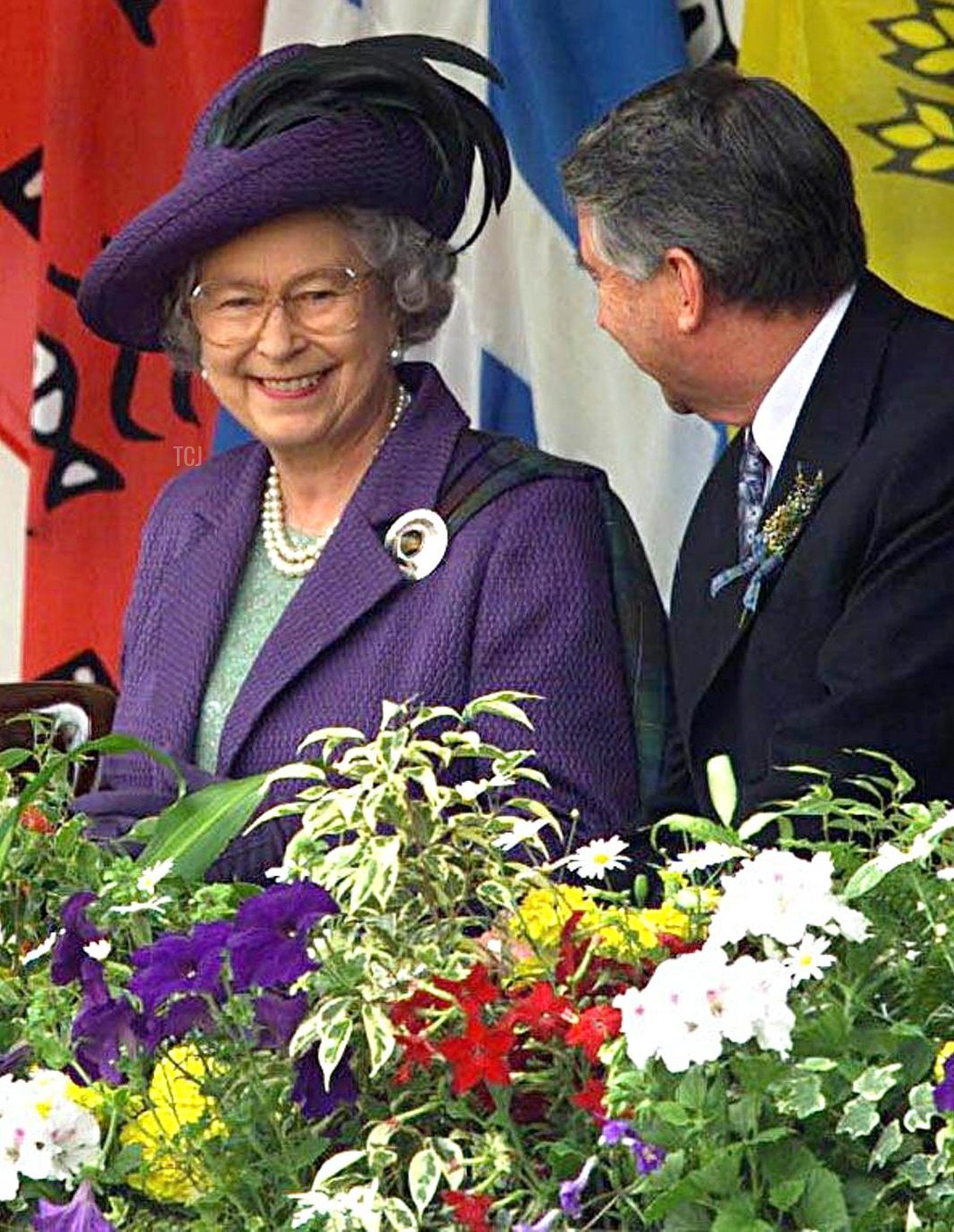 Britain's Queen Elizabeth II smiles with Presiding officer Sir David Steel after the close of the ceremony for the new Scottish Parliament in Edinburgh 01 July 1999