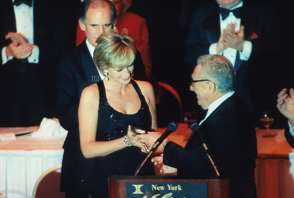Lady Diana Spencer accepts an award from Henry Kissinger at the 41st annual United Cerebral Palsy Awards gala December 11, 1995 in New York City. Lady Diana, the Princess of Wales, received the UCP Humanitarian Award at the fundraising evening
