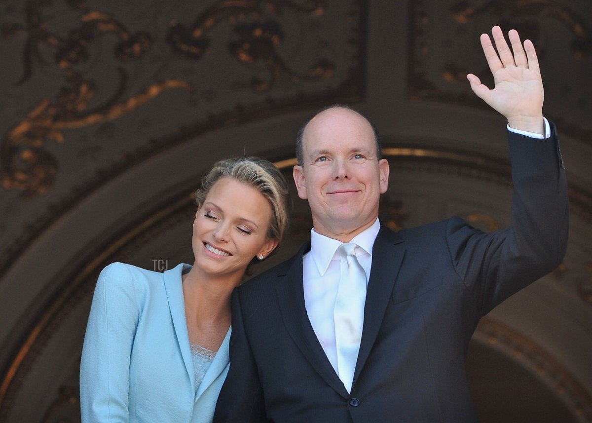 Princess Charlene of Monaco and Prince Albert II of Monaco pose on the balcony after the civil ceremony of the Royal Wedding of Prince Albert II of Monaco to Charlene Wittstock at the Prince's Palace on July 1, 2011 in Monaco