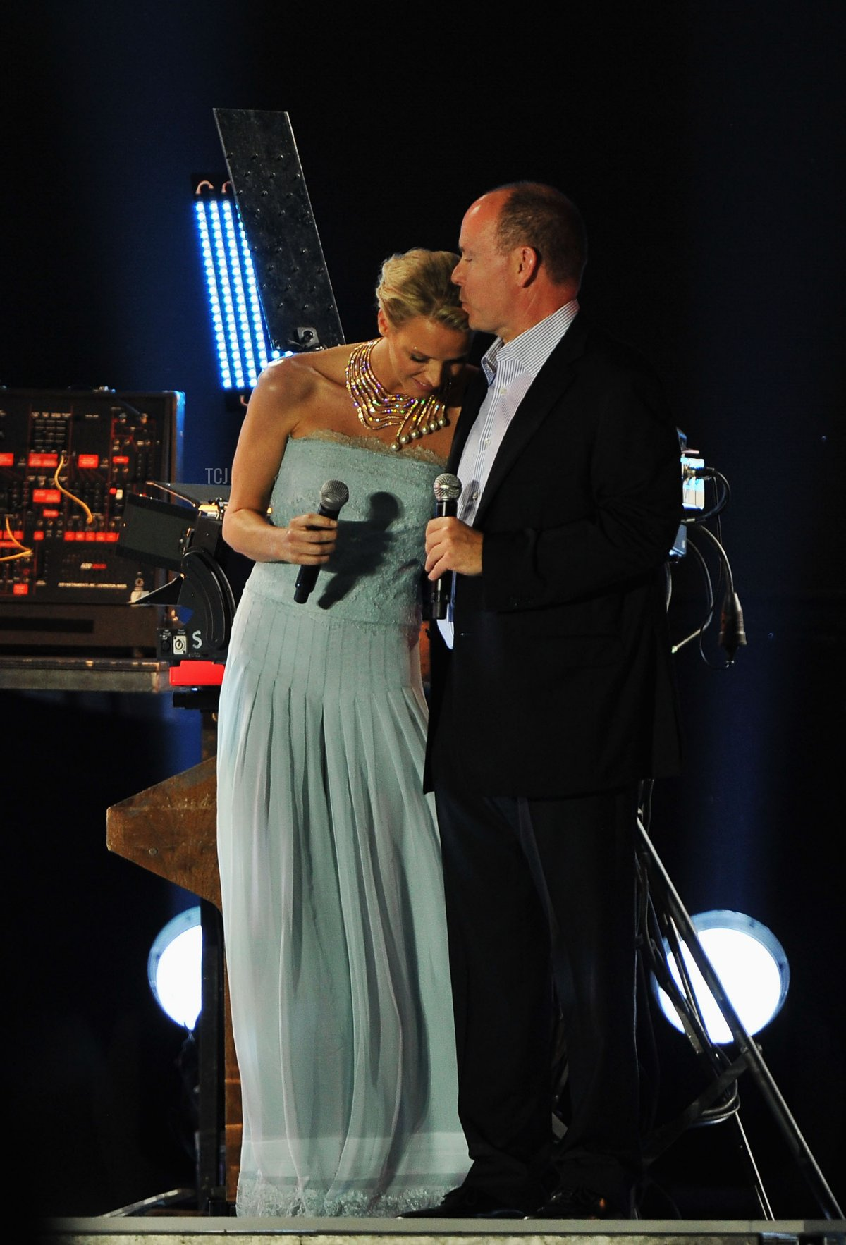 Princess Charlene of Monaco and Prince Albert II of Monaco appear onstage during the Jean Michel Jarre concert celebrating the Royal Wedding of Prince Albert II of Monaco to Princess Charlene of Monaco at the Port of Monaco on July 1, 2011 in Monaco