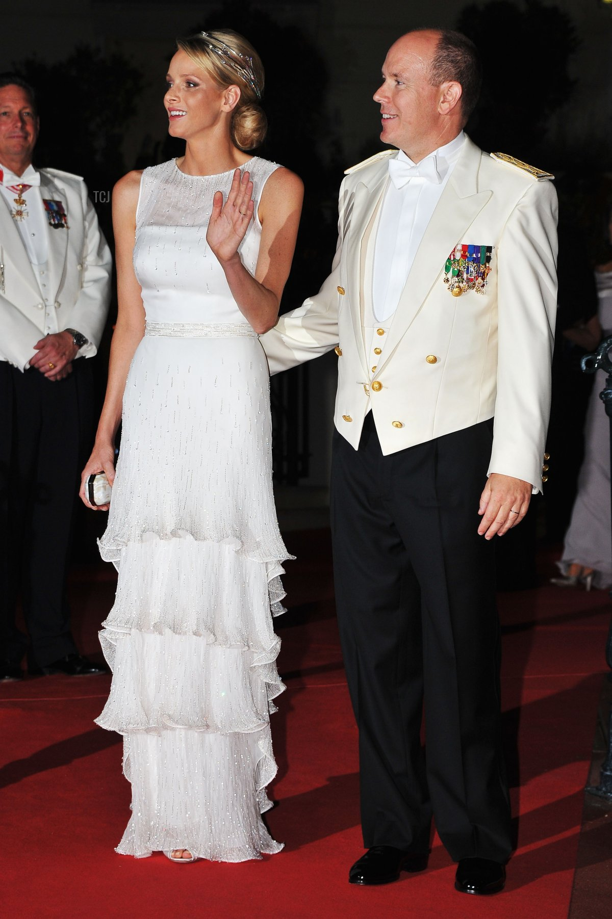 Princess Charlene of Monaco and Prince Albert II of Monaco attend a dinner at Opera terraces after their religious wedding ceremony on July 2, 2011 in Monaco