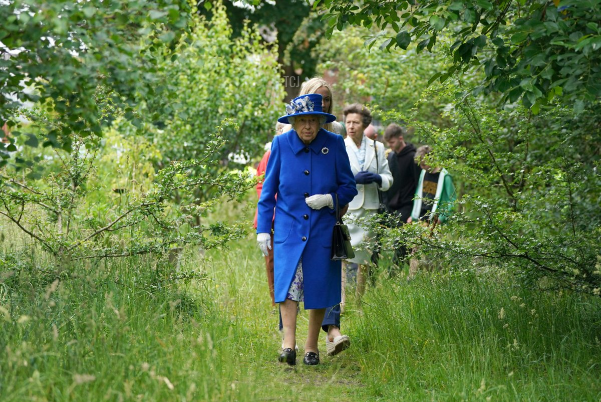 Britain's Queen Elizabeth II takes a walk during a visit to The Childrens Wood Project in Glasgow on June 30, 2021, as part of her traditional trip to Scotland for Holyrood Week