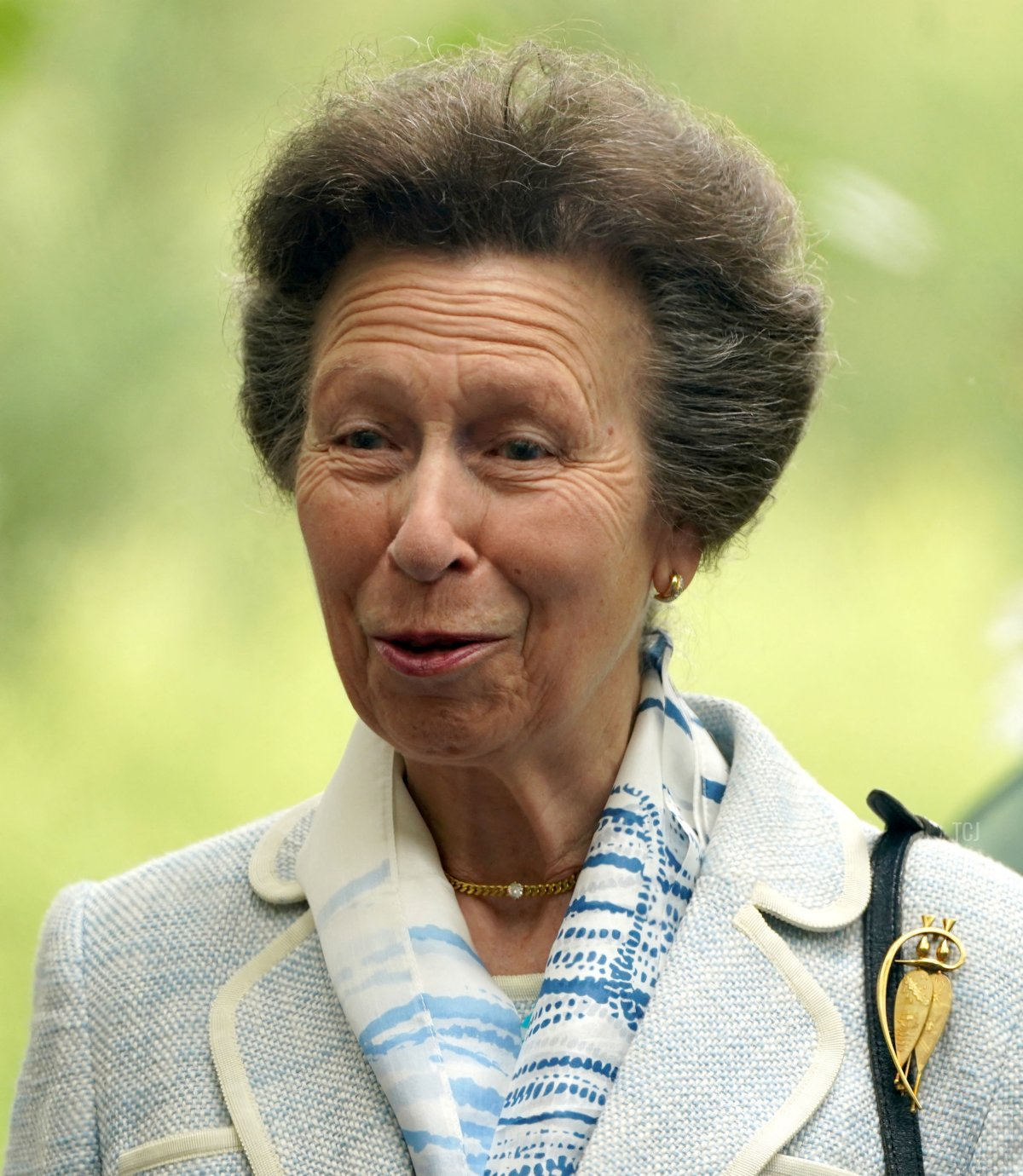 Britain's Princess Anne, Princess Royal gestures during a visit to The Childrens Wood Project in Glasgow on June 30, 2021, as part of her traditional trip to Scotland for Holyrood Week