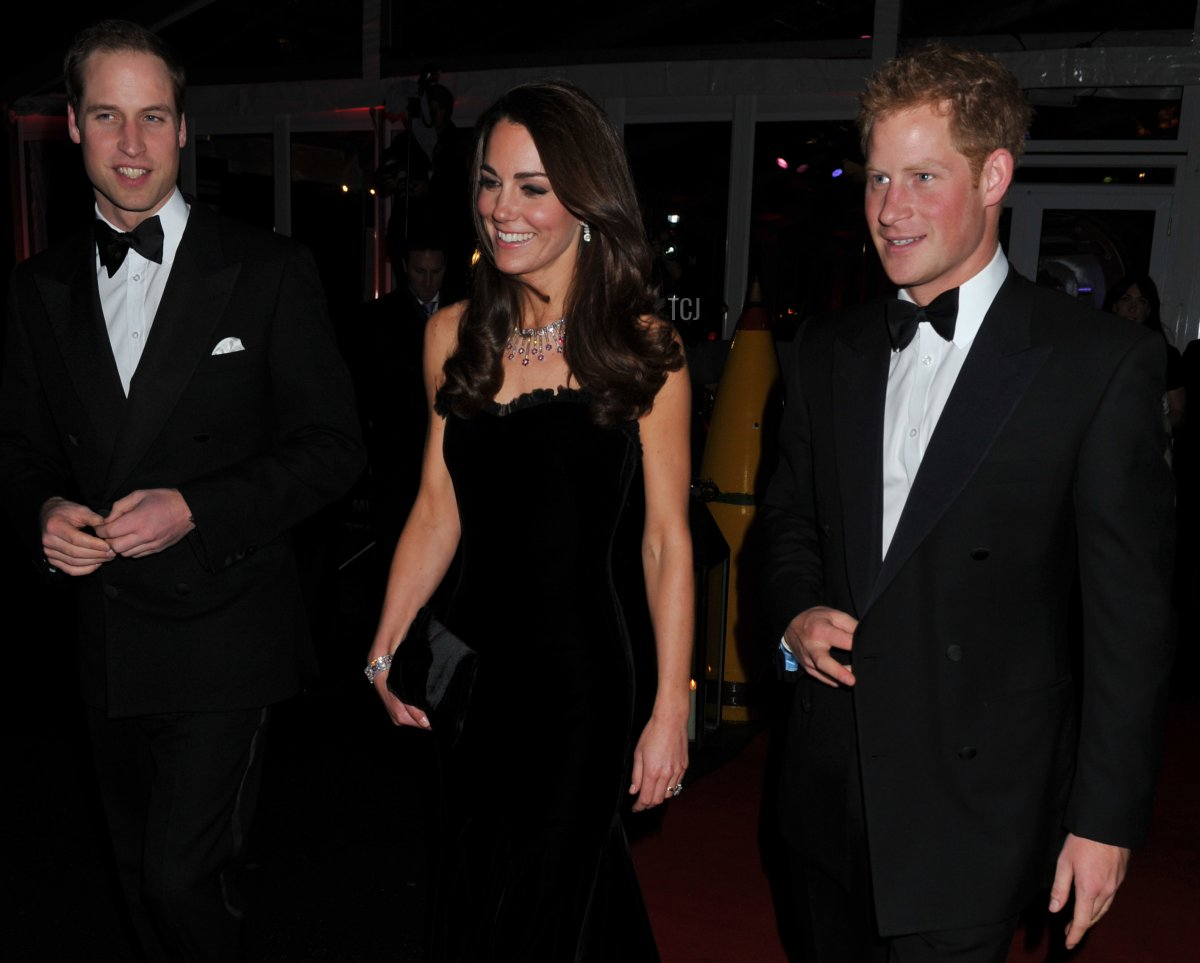"""Britain's Prince William and Catherine, Duchess of Cambridge, arrive with Prince Harry to attend """"A Night of Heros"""", the annual Sun Military Awards, to honour members of the British armed forces in London on December 19, 2011"""