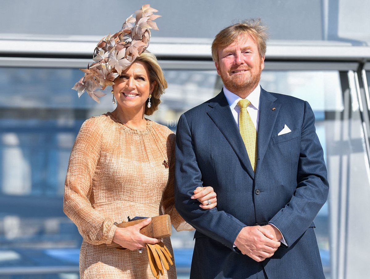 King Willem-Alexander and Queen Maxima of the Netherlands pose outside the cupola of the Reichstag building, housing the Bundestag, the lower house of parliament, in Berlin on July 6, 2021
