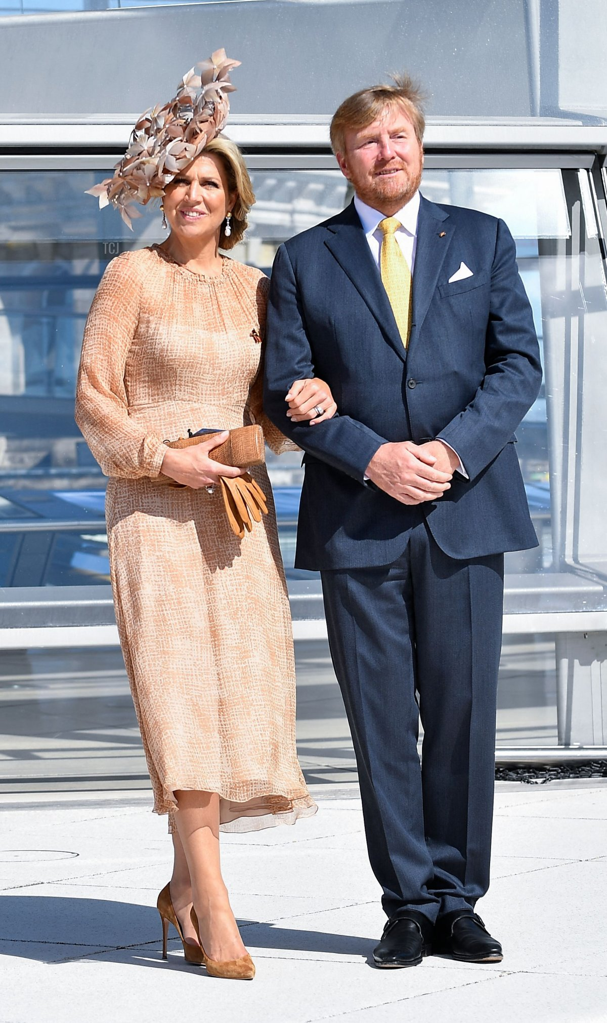 King Willem-Alexander and Queen Maxima of the Netherlands pose outside th cupola of the Reichstag building, housing the Bundestag, the lower house of parliament, in Berlin on July 6, 2021