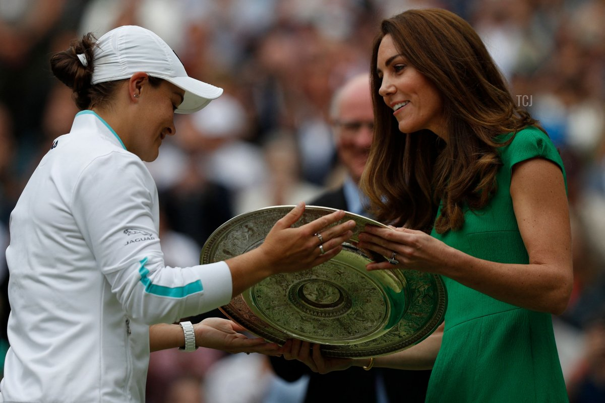 Australia's Ashleigh Barty receives the trophy from Britain's Catherine, Duchess of Cambridge, after defeating Czech Republic's Karolina Pliskova during their women's singles final match on the twelfth day of the 2021 Wimbledon Championships at The All England Tennis Club in Wimbledon, southwest London, on July 10, 2021