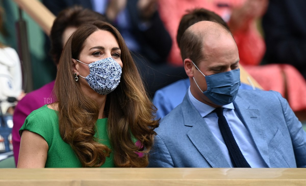 Britain's Catherine, Duchess of Cambridge and Britain's Prince William, Duke of Cambridge, wearing face masks, take their sets in the Royal box to watch the women's singles final on the twelfth day of the 2021 Wimbledon Championships at The All England Tennis Club in Wimbledon, southwest London, on July 10, 2021