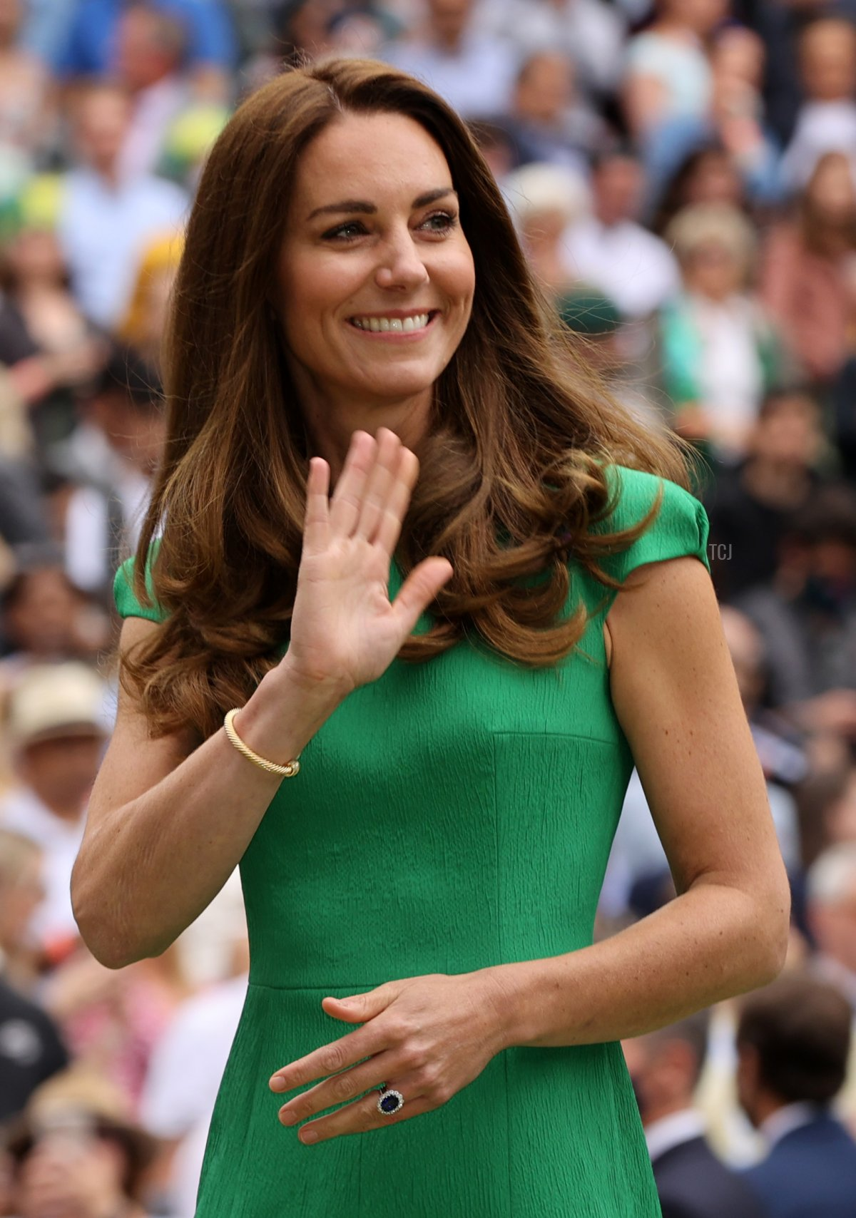 HRH Catherine, The Duchess of Cambridge waves to the crowd after the Ladies' Singles Final match between Ashleigh Barty of Australia and Karolina Pliskova of The Czech Republic on Day Twelve of The Championships - Wimbledon 2021 at All England Lawn Tennis and Croquet Club on July 10, 2021 in London, England