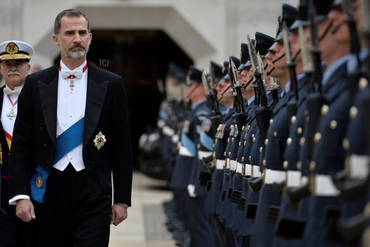 Spanish King Felipe VI inspects a Guard of Honour before a banquet at Guildhall in central London on July 13, 2017, on the second day of the Spanish King and Queen's three-day state visit
