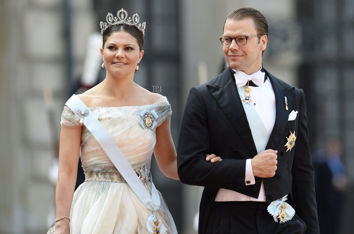 Sweden's Crown Princess Victoria (L) and Sweden's Prince Daniel arrive for the wedding of Sweden's Crown Prince Carl Philip and Sofia Hellqvist at Stockholm Palace on June 13, 2015