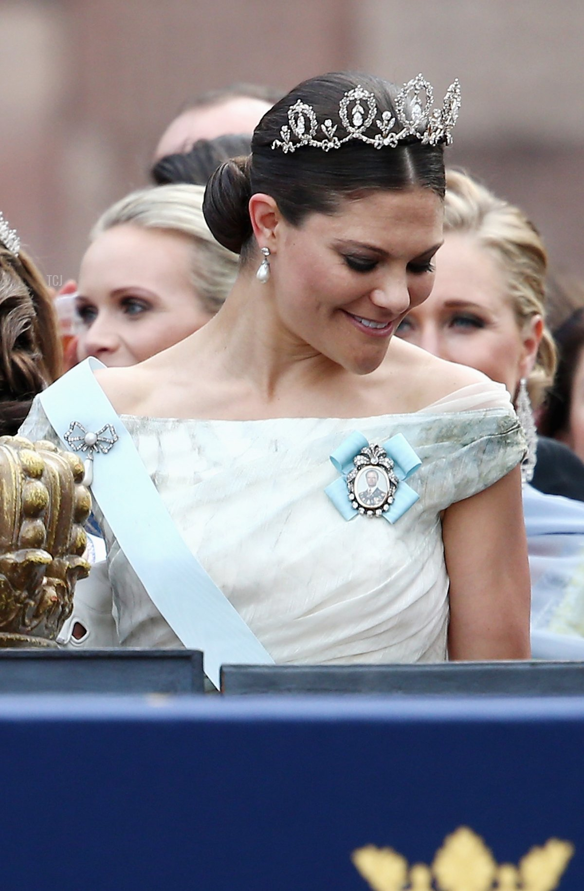 Prince Carl Philip of Sweden places one hand on the crown as he stands next to his sister, Crown Princess Victoria of Sweden, after his marriage ceremony to Princess Sofia, at The Royal Palace on June 13, 2015 in Stockholm, Sweden
