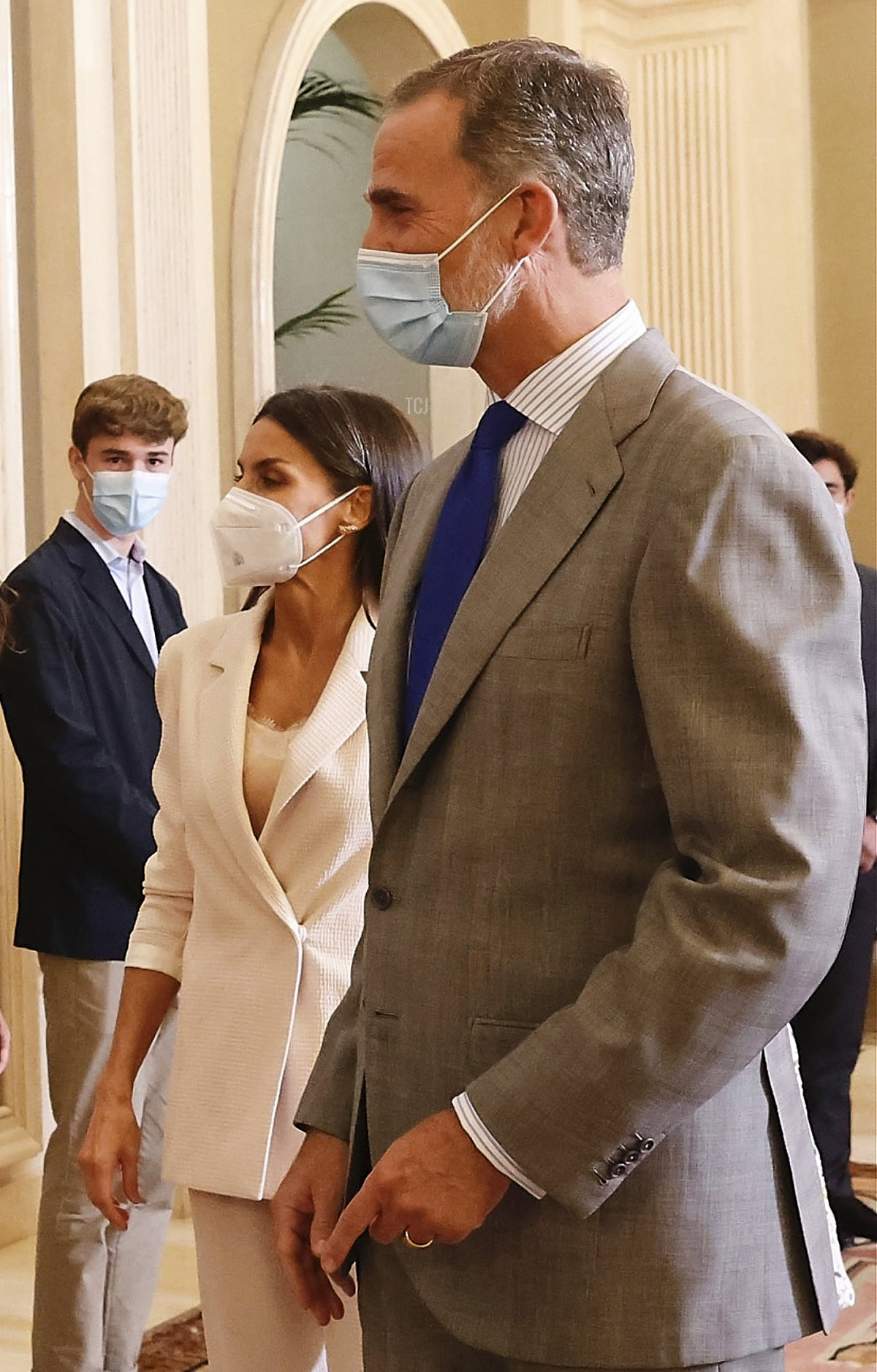 In this handout image provided by the Royal Household, King Felipe VI of Spain (R), Queen Letizia of Spain (2R) and Crown Princess Leonor of Spain (L) receive in audience the members of the United World Colleges (UWC) Spain at Royal Palace on July 13, 2021 in Madrid, Spain